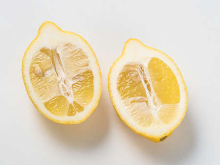two and a half: Two half lemons isolated on a white background