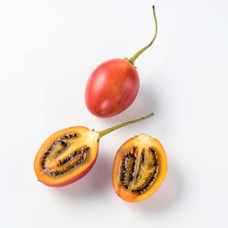 tamarillo: Sweet and tangy tamarillo on white background Stock Photo