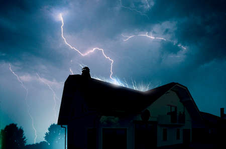 summer house: Lightning in the cloudy storm sky over the house