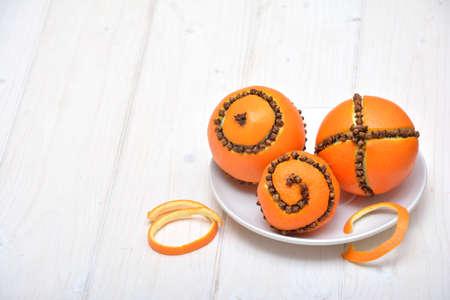 orange peel clove: Christmas decoration - oranges with cloves