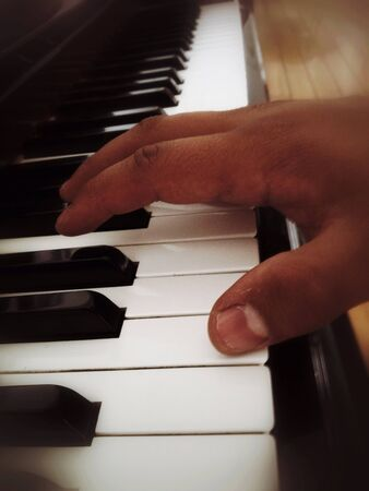 The relationship between ones hand and an instrument is a beautiful mistery Фото со стока