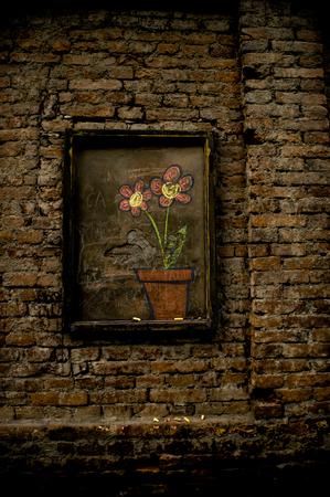window graffiti: Flowers drawing on a brick wall Stock Photo