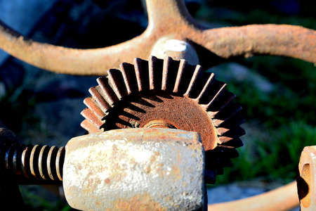 old agricultural machine modes covered with rust
