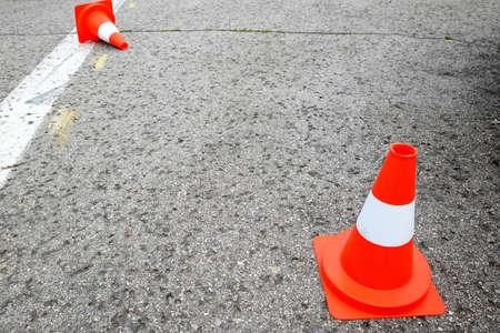 white line on the asphalt and posts warning Reklamní fotografie