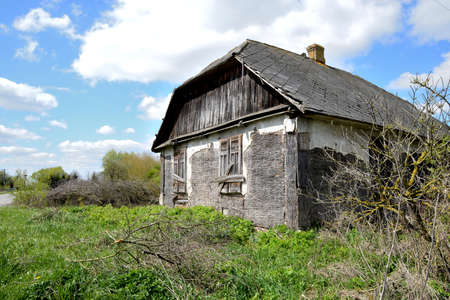 Old wooden abandoned house destroying the wasteland Stock Photo