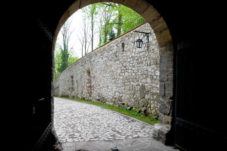 Medieval stone entrance gate to the Benedictine monastery in Tyniec Stock Photo
