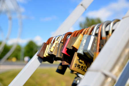 love declaration: Padlocks in love on the bridge on a sunny summer afternoon Wilan?w Warsaw Stock Photo