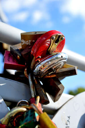 he: Padlocks in love on the bridge Stock Photo