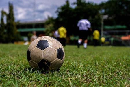 bidding: Thai student playing football