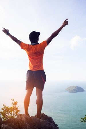 Success achievement climbing, running or hiking accomplish business concept with man celebration.