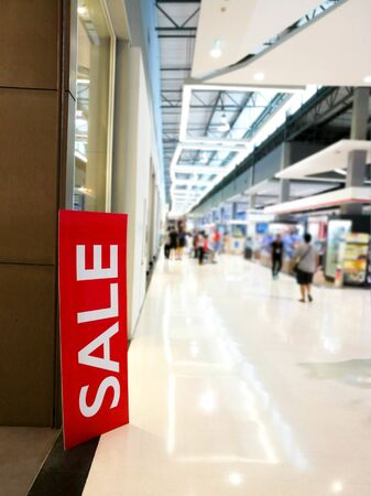 Sale sign in supermarket or shopping center.