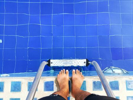 foot of swimmer at the pool.