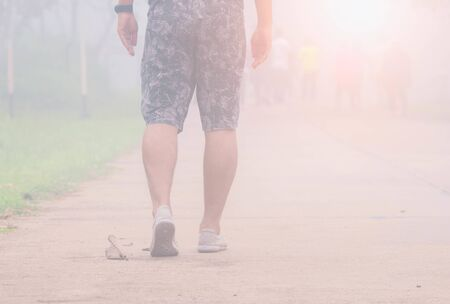 The man walking with fog.