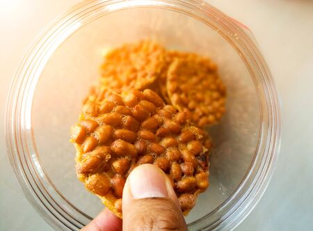 The hand holding fried bean. Stock Photo