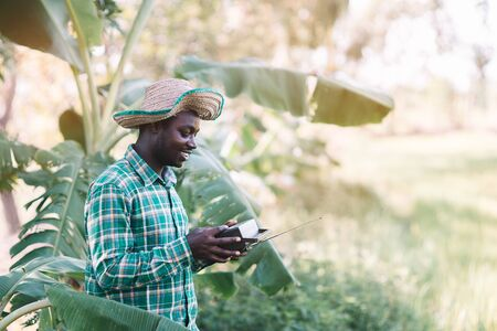 African farmer man holding vintage radio at the farm Reklamní fotografie