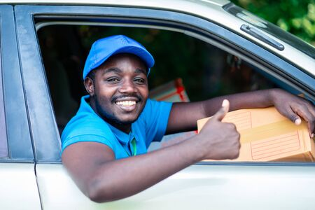African delivery man with very good sign in the car Stok Fotoğraf