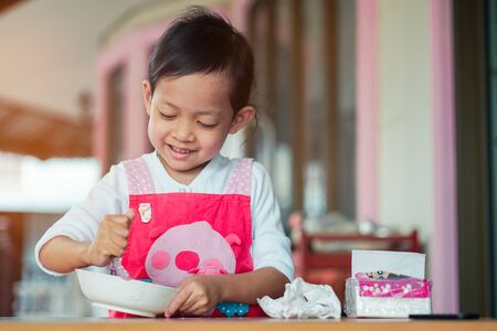 Asian children cooking and smiling with Happiness at home