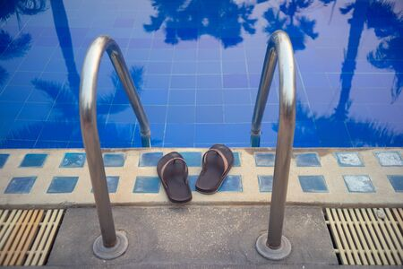 Slippers at the entrance. swimming pool