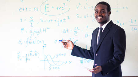 African teacher teaching science in the classroom