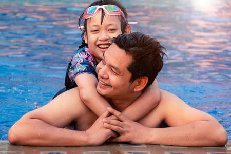 Happy father with little daughter in swimming pool at water park with smile Stock fotó