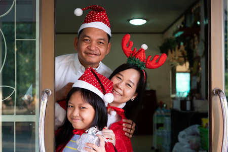 Happy asian family daughter mother and father smiling  in christmas day Stock fotó