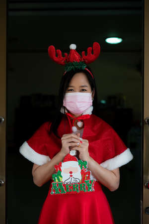 Woman in Santa Claus suit with wearing face mask  in christmas day Stock fotó