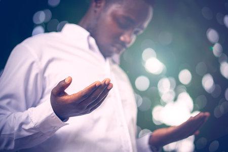 African man praying for thank god.Low key style Stock fotó