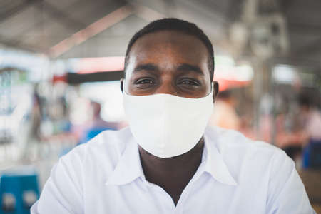African man wearing face mask with white shirt Stock fotó