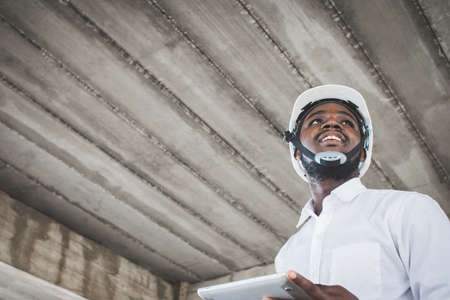 Portrait of African  site contractor engineer with hard hat holding a tablet Stock fotó