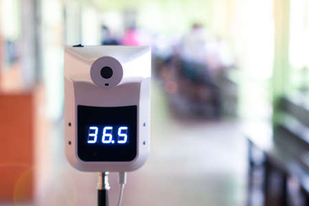 Temperature digital thermometer in school with students for scan prevent and protect from virus before into the classroom
