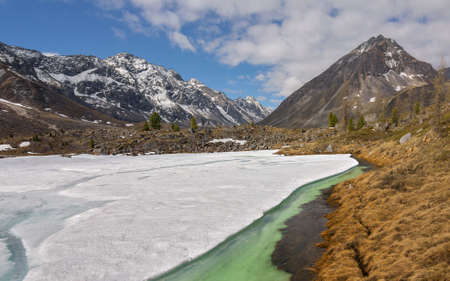 arhat: Ice on the river Arhat in mountains Tunkinskie ridge in june Stock Photo