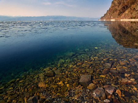 Clean water of Lake Baikal, snow melts in the south a Baikal