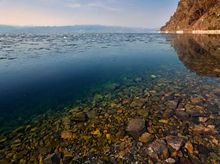 Clean water of Lake Baikal, snow melts in the south a Baikal Banco de Imagens - 89460925
