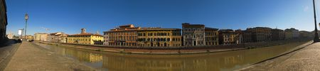 panoramic view across the river arno in pisa, italy