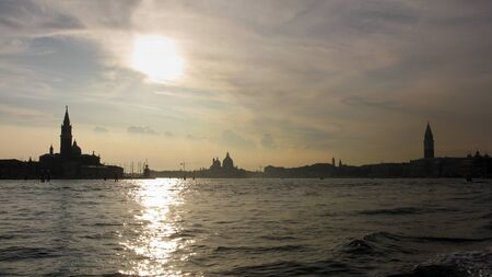Silhouette of venice seen from the water in the late afternoon photo