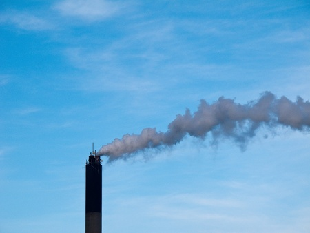 chimney smoke and blue sky in the background photo