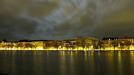 View of the city of Copenhagen along the lakes at night with moon light.