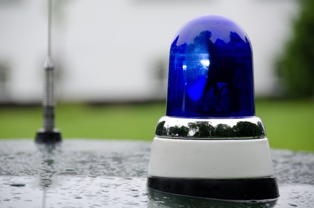 blue police light shining on an old police car in Denmark photo