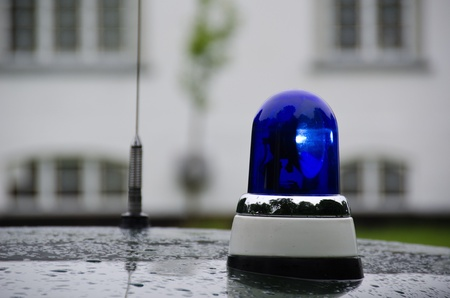 blue police light shining on an old police car in Denmark Stock Photo