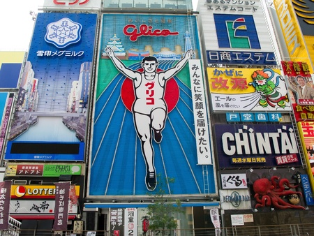 OSAKA, JAPAN - September 09: The famous Glico Man billboard in Dotombori, a popular entertainment district in Osaka on September 09, 2011 in Osaka, Japan