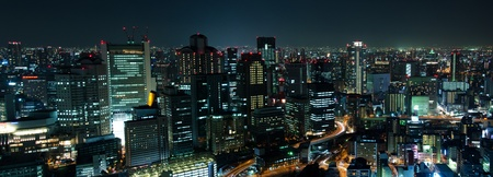 Panorama skyline of Osaka City in Japan at night with lots of lights Stock Photo