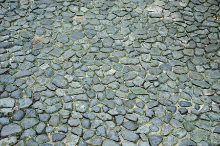 Ancient street made of cobblestones, cobbles, background pattern Stock Photo