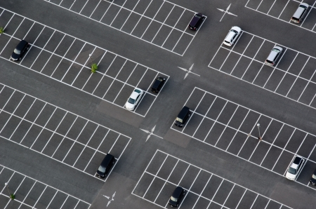 cars parking: Car park seen from above with many empty parking lots