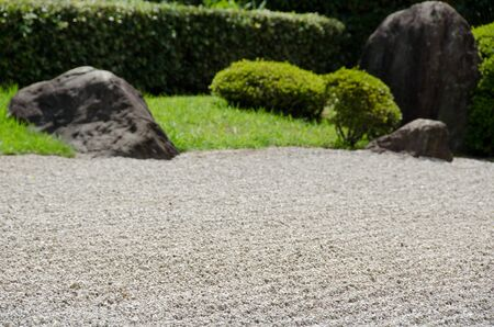 Stone garden of Zen Buddhism in Japan with gravel big stones and grass Stock Photo