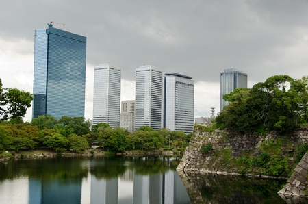 The Skyline of Osaka Business Park with the fortification walls of Osaka castle in the forground