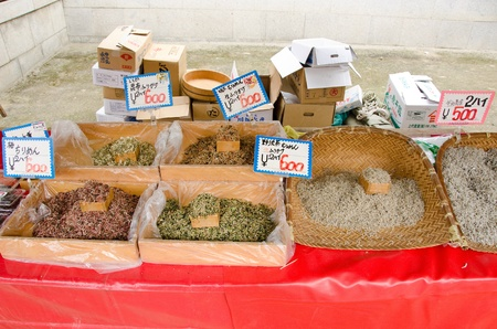 Fish stand in Japan selling dried dried baby sardines, fish also called Niboshi, on a street marked photo