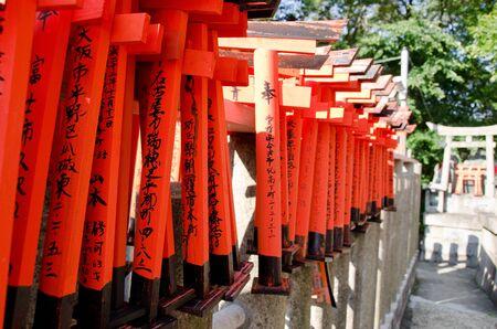 Small torii gates at the fushimi inari shrine in kyoto