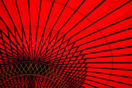 Detail of a traditional red japanese umbrella photo