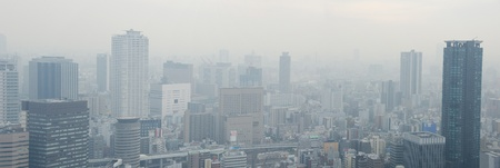 Skyline of Osaka City on a foggy day, smog Stock Photo - 13336883