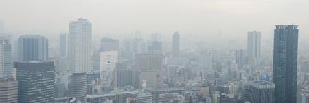 Skyline of Osaka City on a foggy day, smog Stock Photo - 13336883